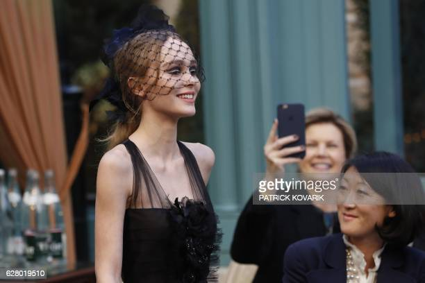 TOPSHOT FrenchAmerican actress and model LilyRose Depp presents a creation for Chanel near former French Culture Minister Fleur Pellerin during the...