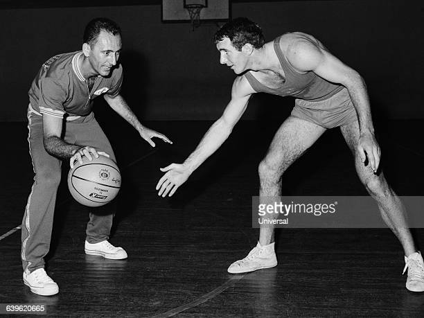 FrenchAmerican basketball legend Bob Cousy conducts a clinic in Paris French player Philippe Baillet participates