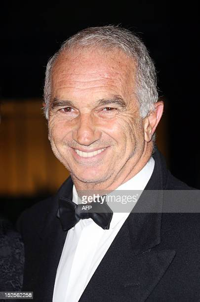 FrenchArmenian film producer Alain Terzian poses as he arrives to attend the inauguration ceremony of the Cite du cinema a film studios complex...