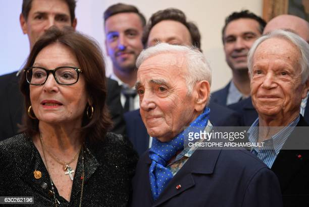 FrenchArmenian singer and writer Charles Aznavour and Greek singer Nana Mouskouri attend the 2016 Nikos Gatsos prize ceremony at the Greek embassy in...