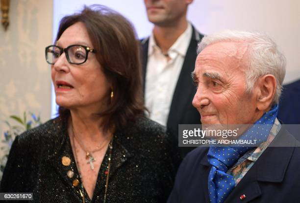 FrenchArmenian singer and writer Charles Aznavour speaks with Greek singer Nana Mouskouri during a ceremony to award Aznavour with the 2016 Nikos...