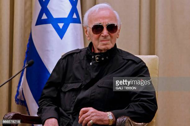 FrenchArmenian singer Charles Aznavour attends a ceremony on October 26 2017 at the presidential compound in Jerusalem Aznavour was presented with...