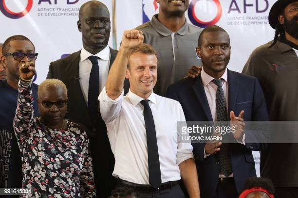 FrenchBeninese artist Angelique Kidjo French President Emmanuel Macron pose for a familly photo with former pro basketball players from NBA Africa in...