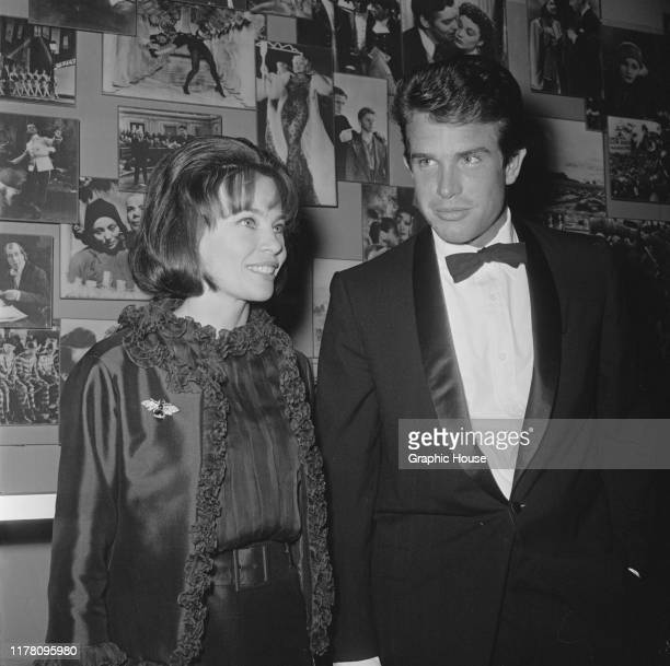 French-born actress and dancer Leslie Caron with American actor Warren Beatty at the premiere of the film 'The Americanization of Emily', USA, 1964.