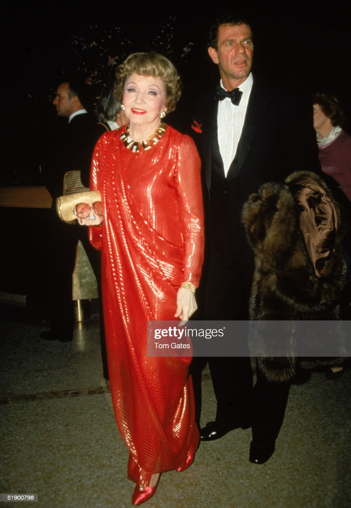 French-born actress Claudette Colbert (1903 - 1996) and companion Peter Rogers attend the opening night of the Costume Institute of Metropolitan Museum of Art (The Met) and its 'Eighteenth Century Woman' exhibit, New York, New York, December 7, 1981.
