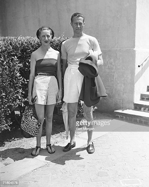 Frenchborn American fashion editor Diana Vreeland and her husband banker Thomas Reed Vreeland both dressed in casual attire stand near the entrance...