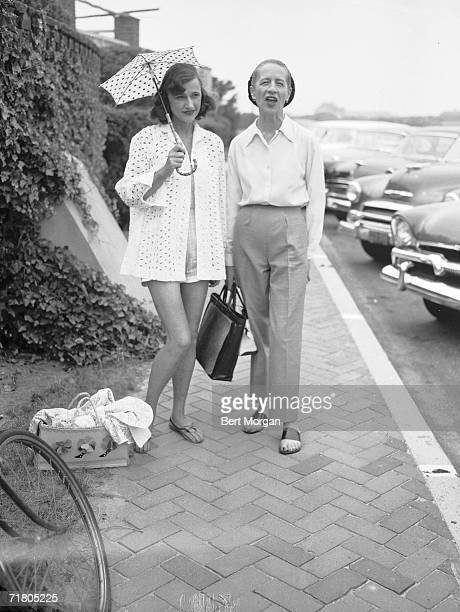 Frenchborn American fashion editor Diana Vreeland and socialite Cordelia Robertson both dressed casually stand on the street probably in front of the...