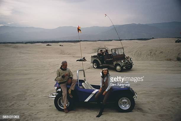 Frenchborn American industrial designer Raymond Loewy and his second wife Viola with their dune buggy in the desert near Palm Springs California...
