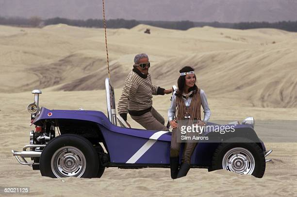 Frenchborn American industrial designer Raymond Loewy with his second wife Viola and their dune buggy in the desert near Palm Springs California...