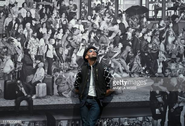 Frenchborn artist JR poses for pictures prior to the opening of his exhibition JR Chronicles at the Brooklyn Museum on October 02 2019 in New York...