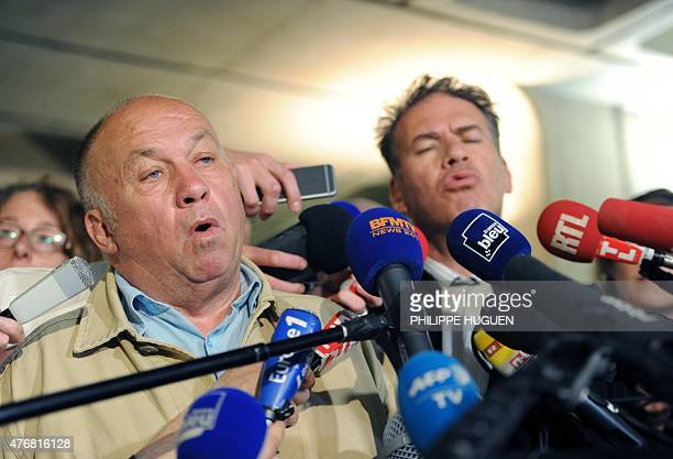 Frenchborn brothel owner Dominique Alderweireld aka 'Dodo la Saumure' speaks to the press as his lawyer Sorin Margulis listens on at the courthouse...