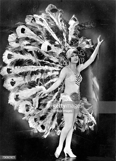 Frenchborn dancer and actress Lili Damita born Liliane MarieMadeleine Carre poses in an elaborate sequined stage dancer's costume with a large...