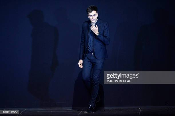 Frenchborn designer Hedi Slimane acknowledges the public at the end of the Saint Laurent Spring/Summer 2013 readytowear collection show on October 1...