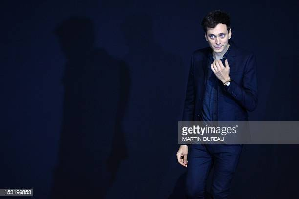 Frenchborn designer Hedi Slimane for Saint Laurent acknowledges the public during the Spring/Summer 2013 readytowear collection show on October 1...