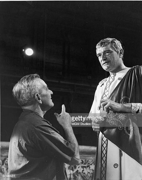 Frenchborn director William Wyler discusses a scene with British actor Jack Hawkins in costume as Quintus Arrius on the set of Wyler's film 'BenHur'