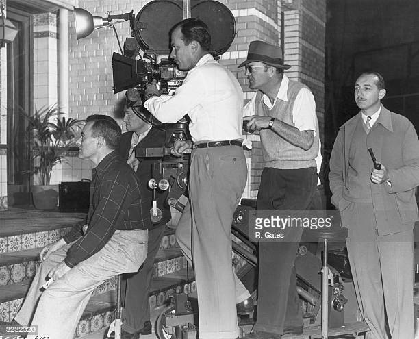 Frenchborn director William Wyler works with members of his production crew on the set of his film 'The Best Years of Our Lives' LR Wyler...