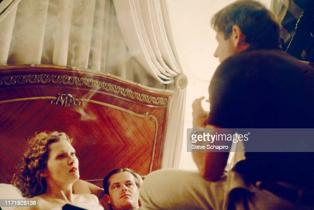 Frenchborn film director Roman Polanski speaks to actors Faye Dunaway and Jack Nicholson on the set of the film 'Chinatown' Los Angeles California...
