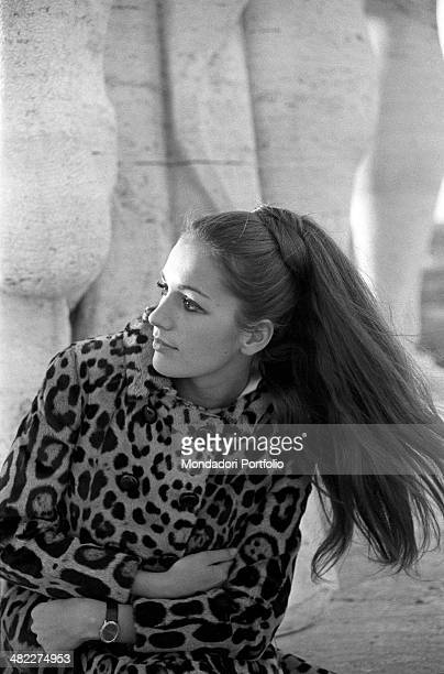 Frenchborn Italian actress and singer Catherine Spaak posing wearing a leopardskin coat at the EUR district Rome 1969