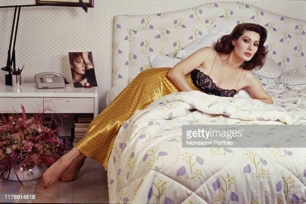 Frenchborn Italian actress Edwige Fenech lying on a bed 1990