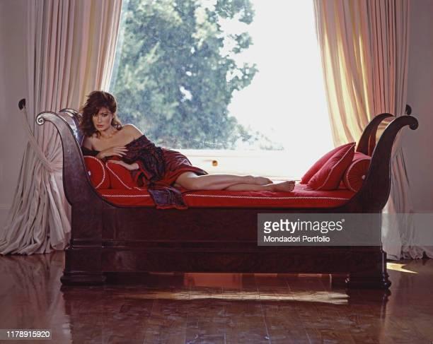 Frenchborn Italian actress Edwige Fenech on a sofa 1989