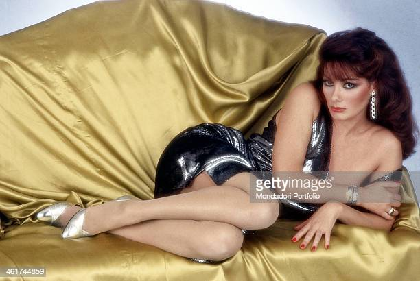 Frenchborn Italian actress Edwige Fenech posing with a seductive look lying on a sofa Italy 1983