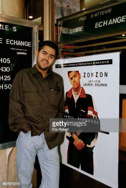 Frenchborn Moroccan actor Jamel Debbouze stands next to a poster advertising his 1998 movie Zonzon