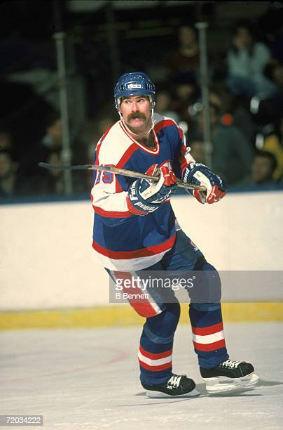 French-born professional hockey player Paul MacLean, forward for the Winnipeg Jets, skates on the ice during a game with the New York Islanders at...