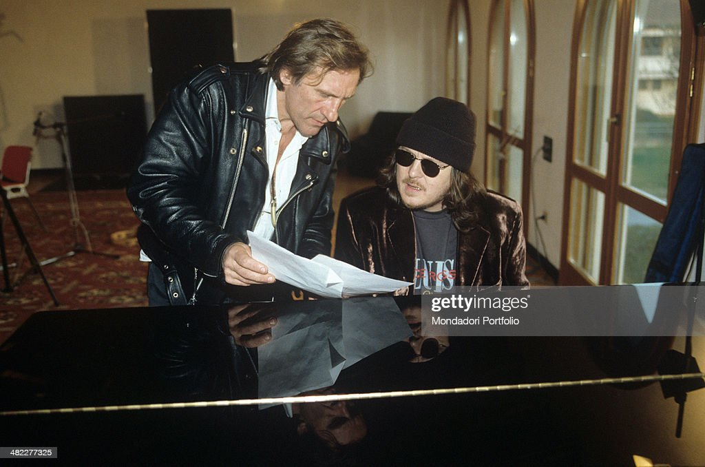 Gérard Depardieu and Zucchero in front of a piano at the Condulmer Recording Studio : News Photo