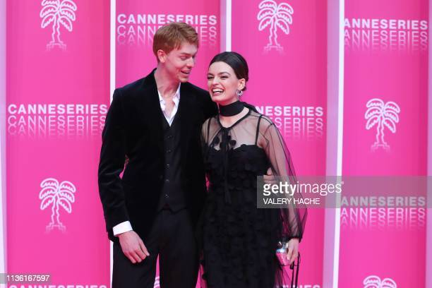 FrenchBritish actress and member of the jury Emma Mackey and her partner Dan Whitlam pose on the pink carpet during the closing night of the 2019...