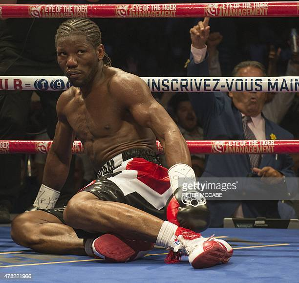FrenchCameroonian boxer Hassan N'Dam sits stunned after going down in the fourth round against Canadian David Lemieux during their IBF world...