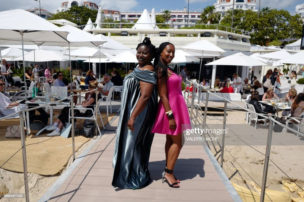 French-Cameroonian Marie-Philomene Nga (L) and French actress Nadege Beausson-Diagne, members of a group of 16 black women who fight for equality and inclusion of black women in the French film industry, pose on May 17, 2018 during a photocall for the book 'My Profession is Not Back' on the sidelines of the 71st edition of the Cannes Film Festival in Cannes, southern France.
