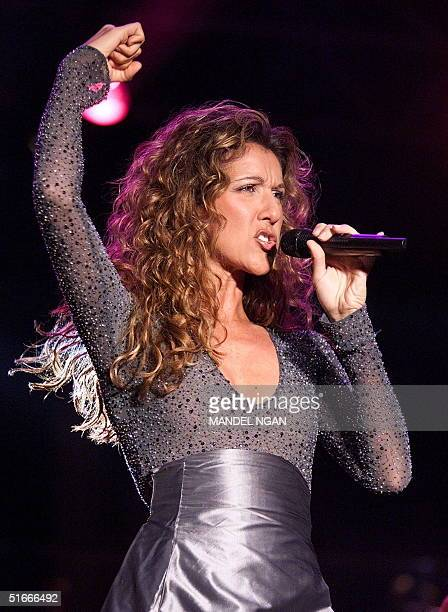FrenchCanadian singer Celine Dion sings 25 January during a concert on the tarmac of Hong Kong's former Kai Tak Airport Dion arrived in Hong Kong 23...