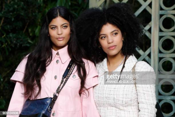 FrenchCuban musical duo LisaKainde Diaz and Naomi Diaz from the band Ibeyi pose for a photocall prior to the Chanel's fashion show during the 2018...