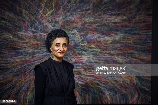 FrenchEgyptian artist Ghada Amer poses in front of one of her work part of the 'Dark Continent' exhibition on May 31 in the nave of the CCCOD Center...