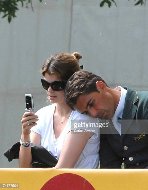 FrenchGreek Athina Onassis sits with her Brazilian husband Alvaro Alfonso de Miranda Neto known as Doda Miranda who is competing in the 97th...