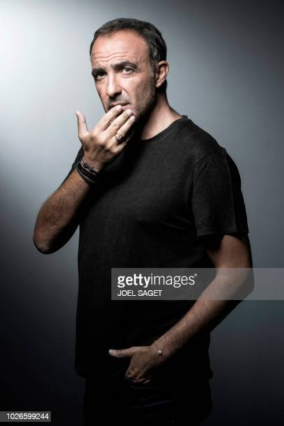 FrenchGreek photographer journalist TV and radio host Nikos Aliagas poses during a photo session on August 30 2018 in Paris