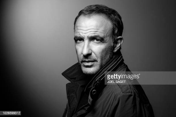 FrenchGreek photographer journalist TV and radio host Nikos Aliagas poses during a photo session on August 30 2018 in Paris / BLACK AND WHITE VERSION
