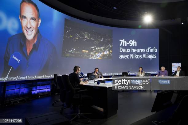 FrenchGreek TV host Nikos Aliagas heads the Europe 1 morning radio show 'Deux heures d'info' in the 'Pierre Bellemare' new studio in Paris on...