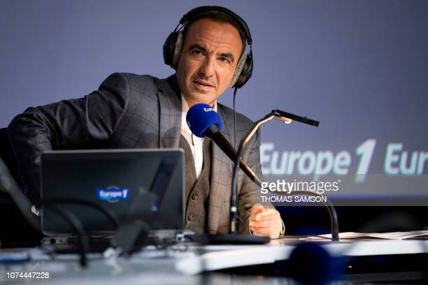 FrenchGreek TV host Nikos Aliagas looks on during the Europe 1 morning radio show 'Deux heures d'info' in the 'Pierre Bellemare' new studio in Paris...