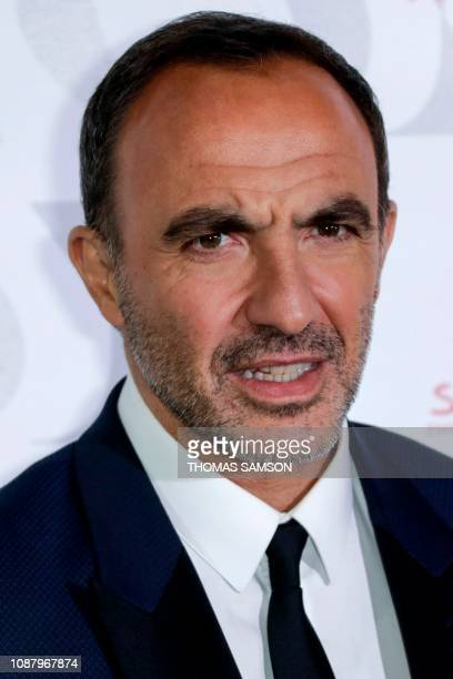 FrenchGreek TV host Nikos Aliagas poses during a photocall upon arriving to attend the 'Diner de la Mode' fundraiser dinner to benefit French...