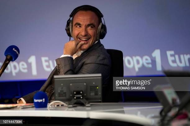FrenchGreek TV host Nikos Aliagas smiles during the Europe 1 morning radio show 'Deux heures d'info' in the 'Pierre Bellemare' new studio in Paris on...