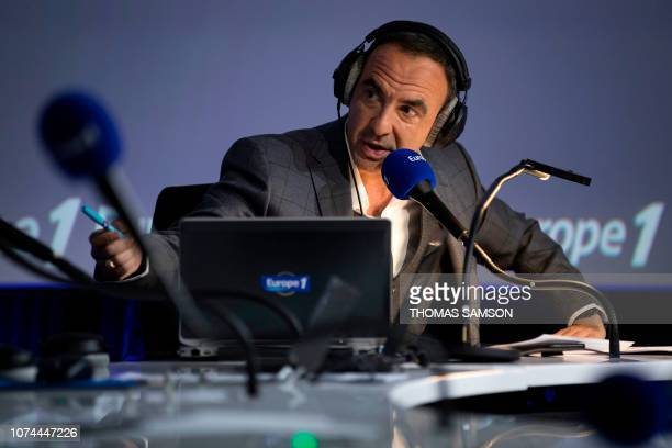 FrenchGreek TV host Nikos Aliagas speaks during the Europe 1 morning radio show 'Deux heures d'info' in the 'Pierre Bellemare' new studio in Paris on...