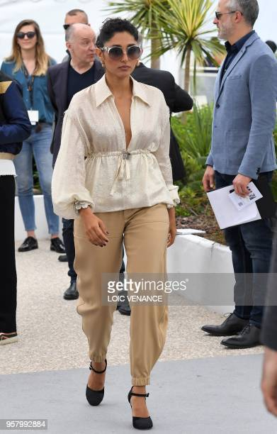 FrenchIranian actress Golshifteh Farahani leaves on May 13 2018 after attending a photocall for the film 'Girls of The Sun ' at the 71st edition of...