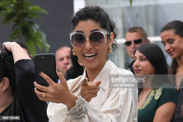 FrenchIranian actress Golshifteh Farahani reacts as she takes photos on May 13 2018 during a photocall for the film Girls of The Sun at the 71st...