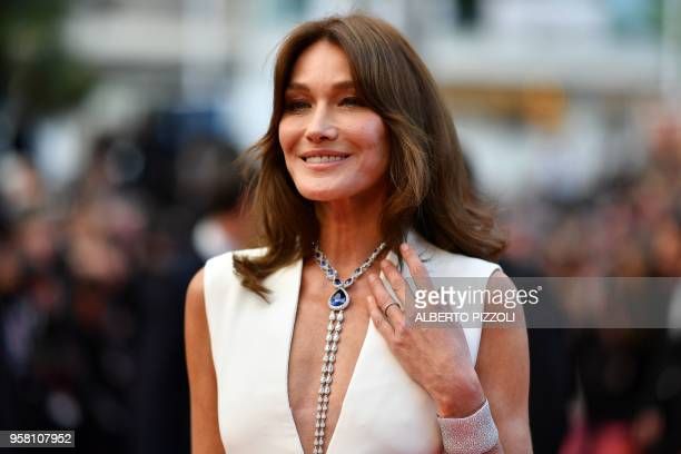 FrenchItalian model and musician Carla Bruni poses as she arrives on May 13 2018 for the screening of the film Sink Or Swim at the 71st edition of...