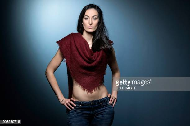 FrenchLebanese actress Laetitia Eido poses during a photo session in Paris on January 8 2018 / AFP PHOTO / JOEL SAGET