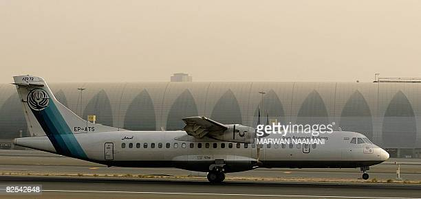A Frenchmade ATR72 owned by Iran's Aseman Airlines sits on the tarmac at Dubai airport on July 29 2008 AFP PHOTO/MARWAN NAAMANI
