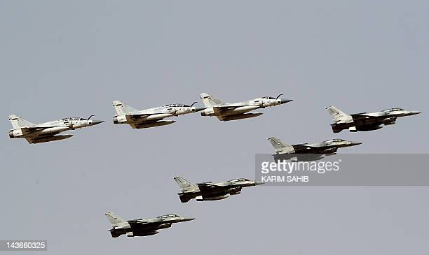 Frenchmade Mirage 2000 and USmade F16 fighter jets of the UAE forces take part in joint military manoeuvres with the French army in the desert of Abu...