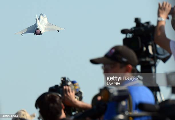 A Frenchmade Mirage 2000 jet fighter takes off from a highway in southern Chiayi county during the annual Han Kuang drill on September 16 2014 Taiwan...