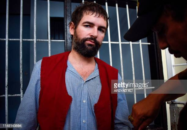 Frenchman Felix Dorfin is escorted back to prison after he was sentenced to death by a court in Mataram on the resort island of Lombok on May 20 2019...
